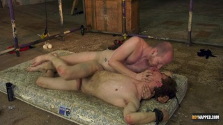 slave boy tied to a dirty mattress and screwed