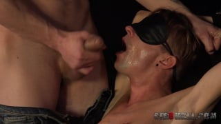 blindfolded guy takes a cum load in his mouth