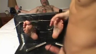 guy in foot stocks gets tickled then sucks cock