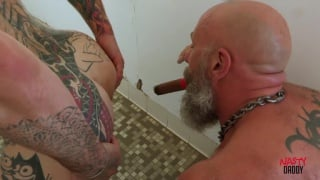 cigar smoking daddy blows smoke up guy's ass