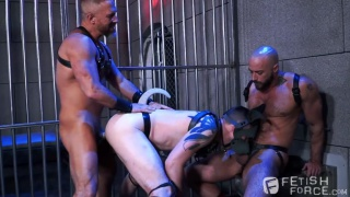 three men fuck in a jail cell