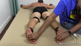 beefy blond hunk strapped face down for tickling session
