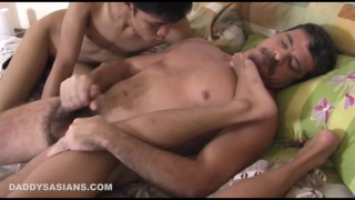 daddy sucks on asian boy's toys while jacking off