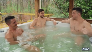 two married men play with a third in the B&B's hot tub