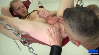 silver daddy fucks a ginger bottom in leather sling