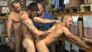 Four Men Gagging on Dicks in Warehouse