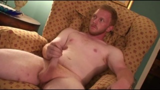 fiery ginger strokes his cock