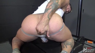 Man Works His Beefy Butt with Dildo in Workshop