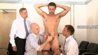 Terry is stripped and searched by suited men