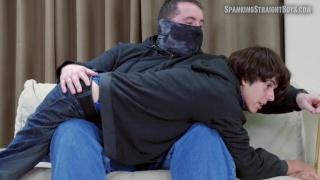 guy in hoodie and jeans gets spanked on man's knee