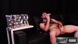 hairy guy sucks a dildo while jacking off
