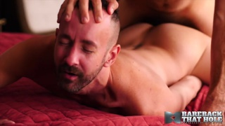 hairy hunk top gives bearded bottom's ass a hard ride