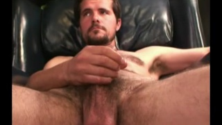 hairy amateur with a goatee strokes his cock