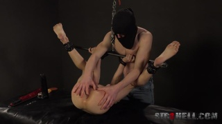 hooded top man spanks his gagged & restrained bottom's ass
