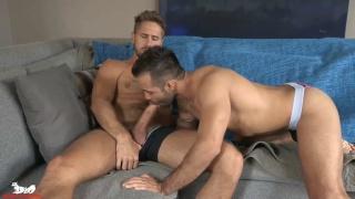 latino hunk sits on a bearded man's long cock
