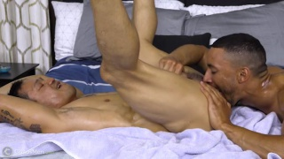 guy oils up this stud's hard body & does some body worship
