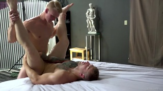 blond stud holds guy's ankles & drills his ass hard