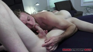 cocksucker tugs guy's shorts to release his cock