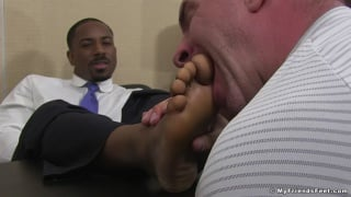 ebony executive gets his feet worshipped in the office