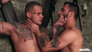 heavily inked stud gets punished while tied to a st. andrew's cross