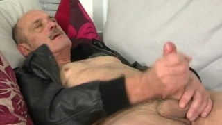 Mature daddy strokes his cock