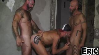 guy follows two men into an abandoned basement