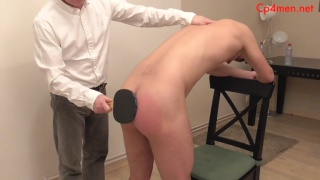 naked guy gets beaten with a ping pong paddle