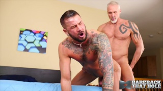 silver daddy drills an hung inked man's ass