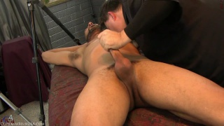 straight stud with a chin-strap beard gets massage table blowjob