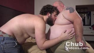 bearded cub plays with a large chub man