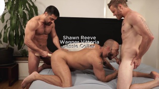 two men share a double-headed dildo and a buddy helps