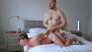 guy holds bottom's hands while fucking his ass
