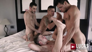 four guys breeding ass in a big bed