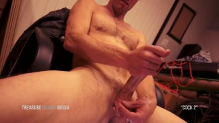 uncut guy cups his nuts while stroking his long dick