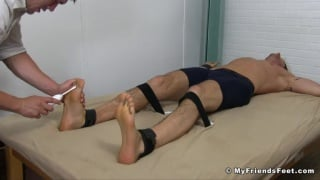 hunk strapped down & tickled with electric tooth brush