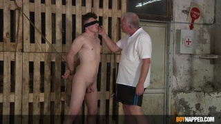 master inspects his new boy then focuses on his balls