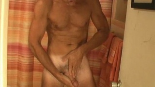 Fit Daddy Blake masturbating
