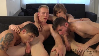 two guys sit side by side while two guys blow them