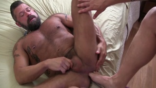 top fucks his bearded bottom's ass with his toes