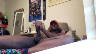 black guy in red baseball cap masturbates