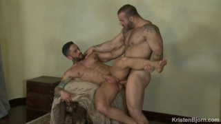 giant beefcake hunk tops a muscle man