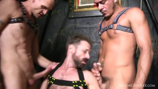 cocksucker services two men wearing leather harnesses