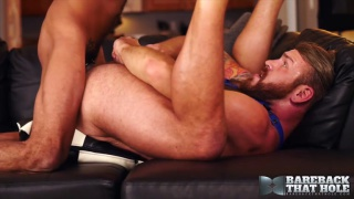 sexy bearded man holds his legs while getting fucked