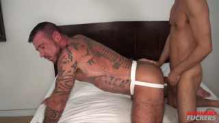inked daddy in jockstrap takes a big dick
