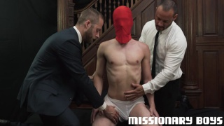 two mormon men play with a masked lad