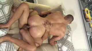 muscle hunk sits his gorgeous ass down on bearded guy's dick
