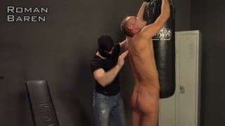 euro boy shackled to a punching bag and spanked