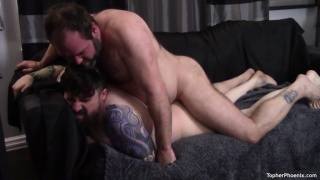 bearded daddy fucks a hot man on the couch