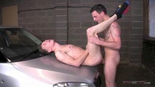 young mechanics fucks on the hood of a car