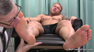 hunk loves having his big bare feet serviced fresh out of his sneakers